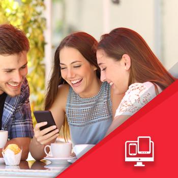 Three friends checking a smartphone - Digital Marketing